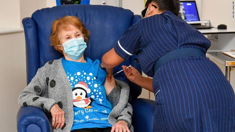 90-year-old Margaret Keenan became the first person in the world to receive a fully vetted Covid-19 vaccine, as the UK began its rollout on Tuesday.